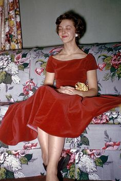 Kodachrome-1953 found photo woman on sofa 50s red velvet party dress full skirt short cap sleeves cocktail hair earrings floral couch