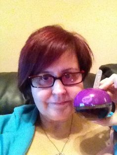 Me with my coveted bottle of limited Addition DKNY Delicious Candy apples perfume