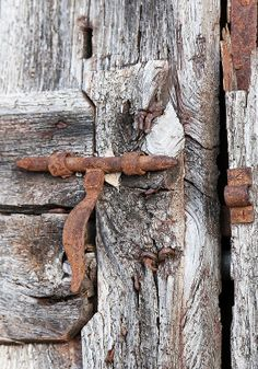 .Weathered wood, rusted metal