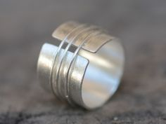 Handmade open band silver ring with three silver wire rings