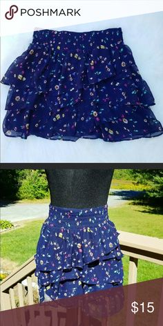 American Eagle Cute floral skirt. Never wore. Too small . Perfect for tween American Eagle Outfitters Shirts & Tops