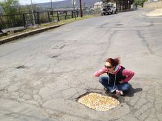 Eating out of a pothole!