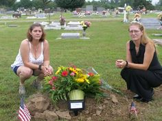 jenn and candi at ian's grave after the service..