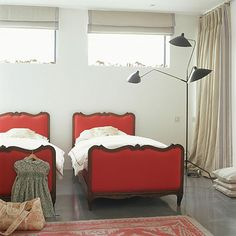antique belgian beds..neutral linen window treatments & what kid doesn't want a serge mouille light!..via livingetc.