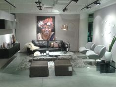 BoConcept Fargo sofa, Volani wall system, Schelly chairs Xtra ottomans & Kuta lamp