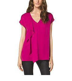An everyday essential with elegant ease, this V-neck top is crafted in soft and airy silk for a luxurious feel and lightweight finish. The outer layer cascades down the front in an asymmetrical line, adding personality and a feminine touch. Balance the flowy fit with a pair of skinny jeans and sky-high heels.