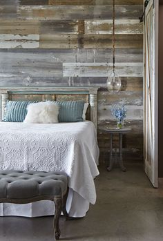 "YES. YES. YES. THIS WALL! Love the headboard, but perhaps a tad bigger and painted with hints of sage green as to pop against the wall. Love the white linen, perhaps layer it with an offwhite chunky cable knit blanket...and we'll have to work on the pillows, nightstand and light. | ""Bedroom, rustic contemporary, reclaimed wood wall, blues and grays"""