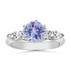 Angara Round Tanzanite and Diamond Ring - Modern Tanzanite Engagement Ring, Tanzanite Rings, Rings With Meaning, Traditional Engagement Rings, Diamond Alternatives, Alternative Engagement Rings, Marquise Diamond, Three Stone Rings, Bridal Jewelry
