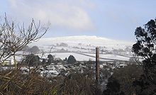 Western Beacon on Dartmoor, England as seen from the town of Ivybridge in January 2010 (the extent of the snow cover is uncommon throughout the winter).