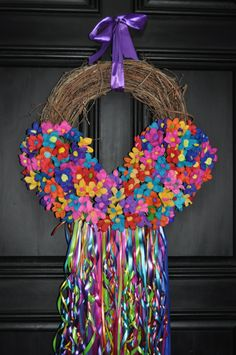 """""""St. Theresa"""" wreath  I have this one in my front entrance! (minus the ribbons).  They are so beautiful!"""