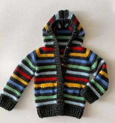 Daisy Farm Crafts Crochet Colorful Stripes Sweater<br> While I shopped at Baby Gap the other day, I saw the cutest striped baby sweater and knew right away… Crochet Baby Sweaters, Crochet Baby Clothes, Crochet Toddler, Crochet For Boys, Free Crochet, Modern Crochet Patterns, Baby Patterns, Baby Pullover, Crochet Jacket