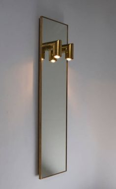 Nanda Vigo; Custom Brass and Glass Illuminated Wall Mirror by Arredoluce, 1970s. #lighting #interiordesign