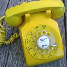 Rotary phones! My sister had one just like this in her room.  I wish I still had it.  Gotta love 70s lemon yellow!