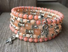 RESERVED Calming Coral Multi Strand Memory Wire Coil Bracelet With Hope Ribbon Charms