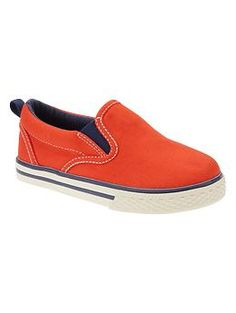 Sunwashed slip-on sneakers. The boys love the canvas shoes in red and orange colors for this summer!