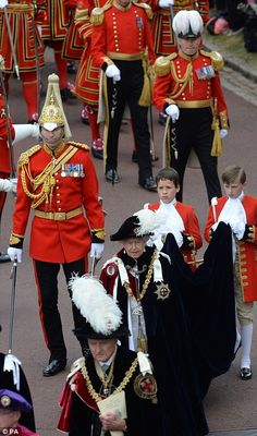 Helping hand: The Queen wore a velvet cloak so long and heavy, two page boys were needed t. Princess Anne, Princess Margaret, Princess Victoria, Queen Victoria, Queen Mary, Queen Elizabeth Ii, Alfred The Great, George Cross, Order Of The Garter