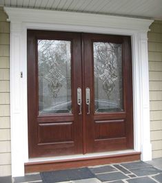 Double front doors with arched true divided lites front door