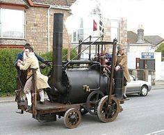 """British inventor Richard Trevithick takes seven of his friends for a test ride on his """"Puffing Devil,"""" or """"Puffer,"""" the first steam-powered passenger vehicle - 1801."""