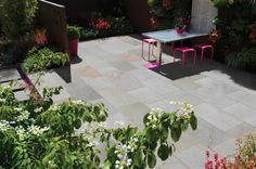 This lovely garden area is fully paved yet still looks warm and welcoming.  #paved #gardens #maintenance