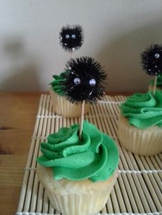 Totoro birthday party. Soot sprite cupcake topper. Tinsel pom pom ball with mini google eyes glued on. Stick onto an extra long toothpick and you're set!