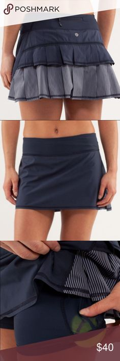 Lululemon Pace Setter Skirt Pace Setter Skirt in inkwell and wagon stripe inkwell. Shorts underneath have silicon grips. Pocket on the shorts is perfect if you play tennis! lululemon athletica Skirts