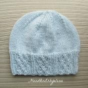 Blue Hat with Traveling Cables - via @Craftsy
