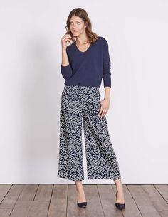 These drapey trousers are a must for your holiday suitcase. The cropped shape and flowing material makes wearing them a breeze, while the fit is feminine and flattering. They're made for pairing with a pretty white top and tan heels when night rolls around.