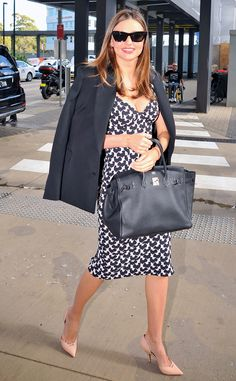 Miranda Kerr from The Big Picture: Today's Hot Pics  The model and mom accompanies a pregnant pal on a hospital visit.