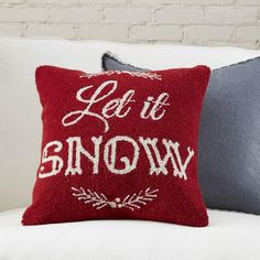 Let it Snow Hooked Pillow | This pillow's retro type offers a charming look that can be used all season long