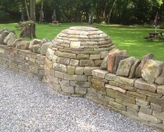 Boundary wall of a pub featuring a dry stone sculpture, in the Forest of Dean, Gloucestershire, UK Compound Wall Design, Stone Retaining Wall, Boundary Walls, Stone World, Crystal Garden, Stone Bench, Stone Masonry, Dry Stone, Paving Stones