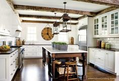 LOVE rustic + white. Beams in kitchen.