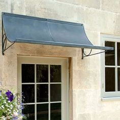 Front door canopies made from zinc galvanized steel. Any porch canopy made to fit over your door by Garden Requisites.