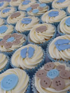 Christening cupcakes - decorated with vanilla buttercream and fondant baby feet and buttons.