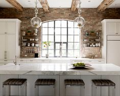 Stunning Fake Brick Wall Kitchen to Create Your Kitchen Walls : Exclusive Brick Wall Kitchen As Your Inspirations With White Kitchen Cabinet Kitchen Rack Gray Windows Frames Marble Kitchen Island With Chairs Wooden Ceiling Panels