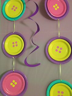 Button decorations made from 2 different paper plate. Just glue and add 4 round yard sale price labels and voila! Instant decor for a Lalsloopsy party. Cheap and easy to do!