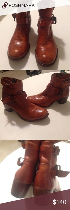 Italian made moto boots Saddle color leather booties. Zips on inner leg. Double belted design. Gun metal buckles. Leather soles. Rubber signature emblem on soles. Durable leather 2' heels. Very good condition. Super nice  & stylish Moma Shoes Ankle Boots & Booties
