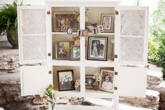 Sweet way to display old family photos. Photo by Jen and Chris Creed Photography #cedarwoodweddings
