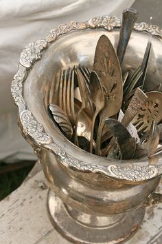 Vintage silverware in a champagne cooler