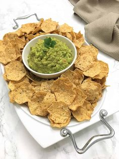 Learn how to make the BEST guacamole EVER. This simple homemade Mexican dip has a secret ingredient to eliminate all the chopping and prepping. Guacamole has never been this easy or simple to make, yet absolutely delicious!