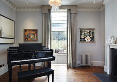 This beautiful room in a listed terraced house in London has tastefully been refurbished keeping the original details while adding modern art and a grand piano. The large glazed doors lead out into the new extension beyond. Architects London, Residential Architect, Richmond Hill, Grand Piano, Contemporary, Modern Art, New Homes, Traditional, The Originals