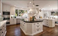 Clear example of light perimeter counters and dark countertop on white island.