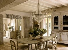 Weathered whites, gorgeous dining room chandelier, table n chairs, cupboard etc...