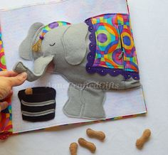This fun, handmade toy for little kids is a great gift idea. Also creative ideas for your own felt quiet book page.  Children will love feeding the felt elephant!  #AnneCraftedGifts