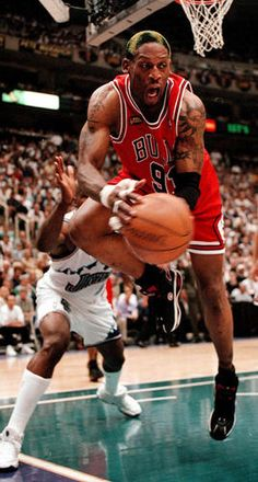 Bulls Dennis Rodman lunges for a rebound during the 2nd quarter of play in the 1998 NBA Finals. (Tribune file photo). See more vintage Bulls photos here: http://www.redeyechicago.com/sports/redeye-vintage-bulls-photos-relive-the-glory-years-and-more-20130301,0,2059830.photogallery