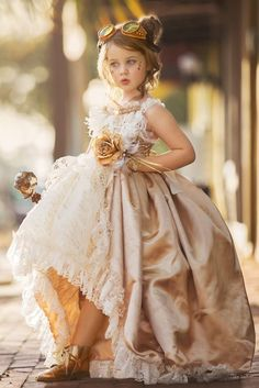 She will feel like royalty in this Custom Made special occasion gown from Love Baby J! Intricate details like embroidered mesh with sheer sequin fabric, a beautiful satin overskirt, and a stunning rem