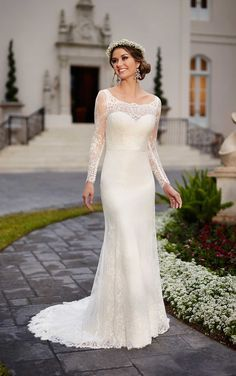 """This lace over Matte-side Lustre Satin sheath wedding dress from Stella York features an elegant illusion lace neckline and a figure-flattering 1"""" Grosgrain Ribbon waist sash."""