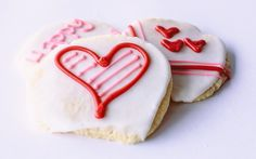 More cute Valentine's Day cookie designs using white, red, and pink frosting.