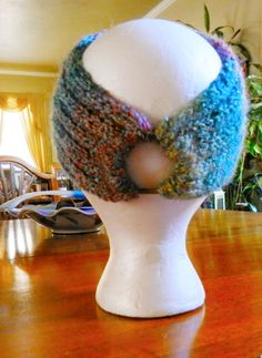 Whip stitch bound off edges of a knitted headband to a ponytail elastic....love the idea!