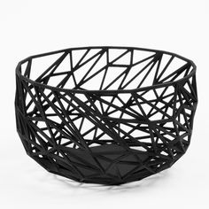 This versatile bowl would work just as well in the kitchen as it would as a decorative accent in the living rom. $106, themfamily.fr   - ELLEDecor.com