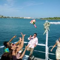 Wedding bouquet being thrown on the Ubervida yacht